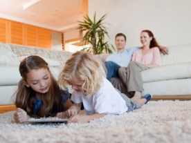 Children using tablet on the carpet